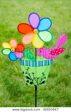 Colorful Double Pinwheel With Bird On Green Grass