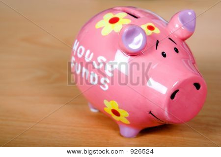 Piggy Bank On A Wooden Surface