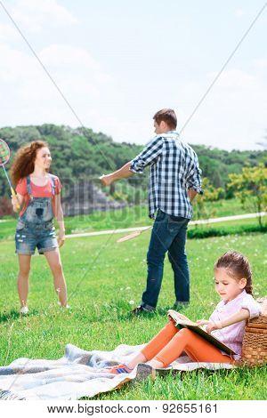 Happy family playing badminton