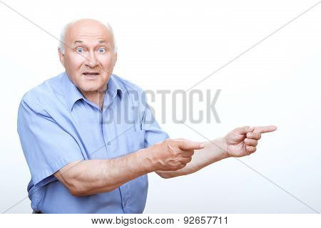 Astonished grandfather pointing to the left