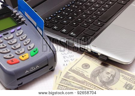 Payment Terminal With Credit Card, Money, Laptop And Financial Calculations