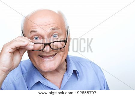 Nice grandfather touching spectacles