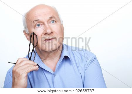 Nice grandfather holding glasses