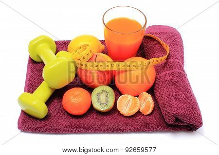 Fresh Fruits With Tape Measure, Glass Of Juice And Dumbbells