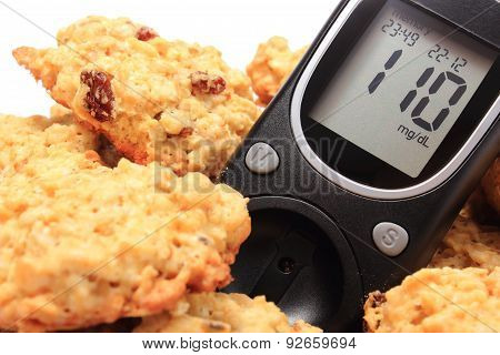 Glucose Meter And Oatmeal Cookies On White Background