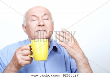 Nice grandfather smelling tea aroma