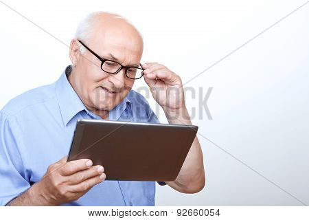 Pleasant grandfather surfing through the Internet