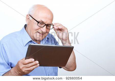 Pleasant grandfather surfing through the Internet