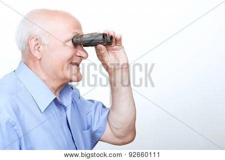 Smiling grandfather looking through binoculars