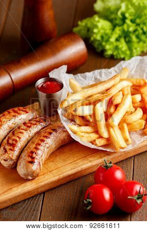 Fried sausages with fries