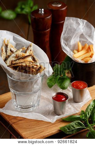 Sprat and french fries with gravy