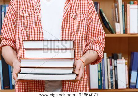 Man hands in a library