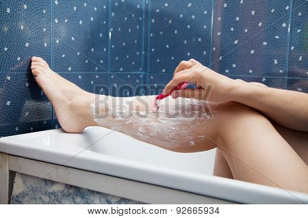 Woman Shaves Leg