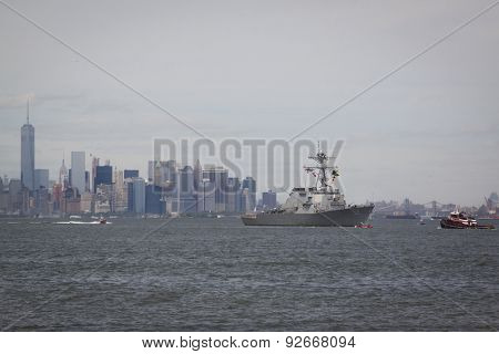 STATEN ISLAND, NY - MAY 20 2015: USS Barry (DDG 52) approaching Sullivans Pier with the buildings of Lower Manhattan in the background at the beginning of Fleet Week.