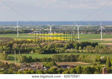 Wind Turbines In Flat Landscape