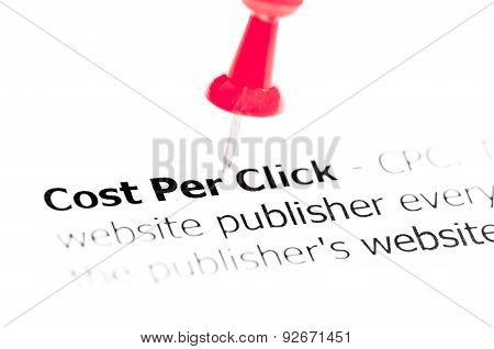 Words Cost Per Click Pinned On White Paper With Red Pushpin