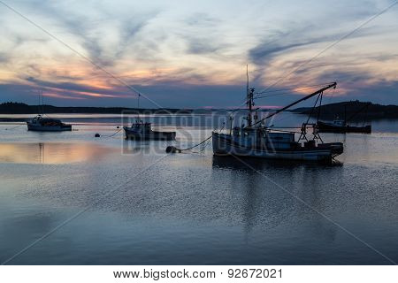 Fishing Boats At Sunset In Calm Cove