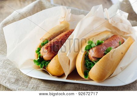 Two Hotdogs On Wooden Table