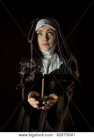 Nun With Candle.