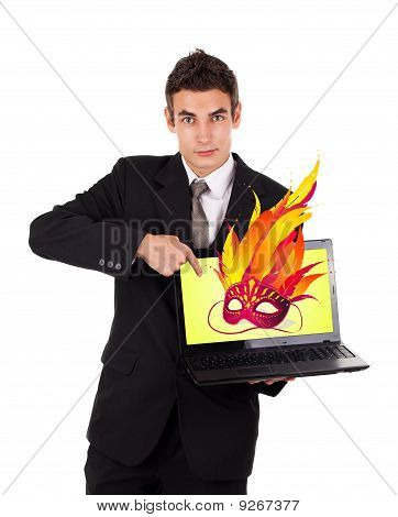 Business Man Pointing At A Laptop With Mask