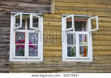 white windows of old wooden house