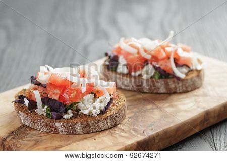 homemade bruschetta with ricotta tomatoes and herbs