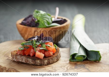 homemade bruschetta with tomatoes, basil and leek