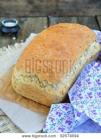 Homemade bread with oat flakes, linseed and black sesame seeds