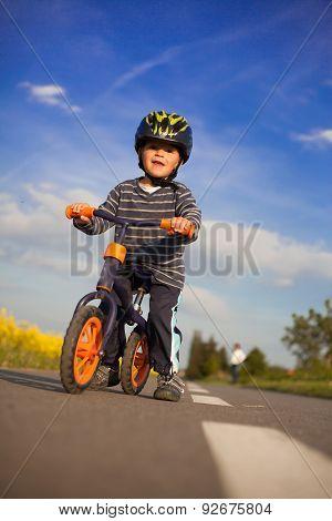 Little Boy Is Learning To Bike.