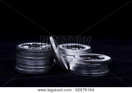 Stacked Up Silver Coins.