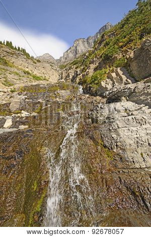 Mountain Stream Rushing Down The Slope