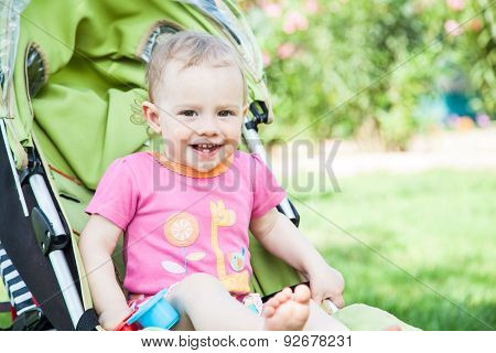 Young girl in carriage.