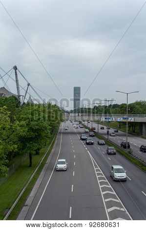 Munich, Germany - May 14, 2015: Turning lane on a road with the O2 Tower in the background