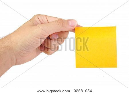 Hand holding a yellow notepaper or postit isolated on a white  background