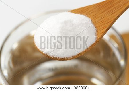 detail of cooking soda on wooden spoon