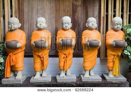 Buddhist Monk Statues With Orange Robe