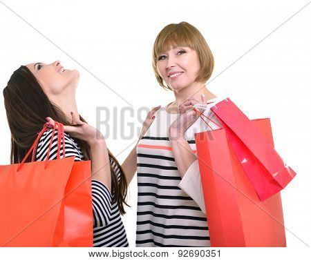 Happy mother and daughter holding red shopping bags. Sale, purchase, shopping.