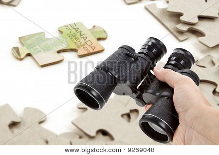 Binoculars And Canadian Dollar Puzzle