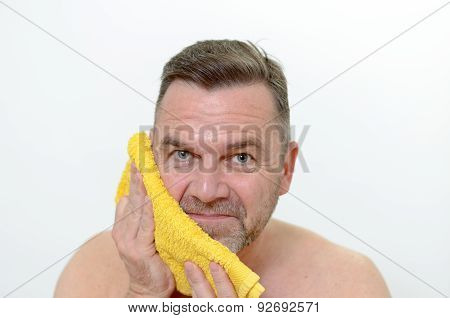 Happy Middle Age Man Drying His Cheek With Towel