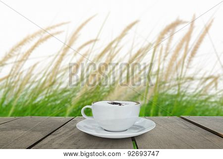 Fresh Green Grass In Beautiful Meadow And Coffee Cup On Veranda