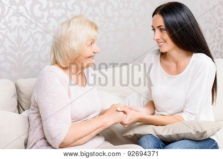 Granny and granddaughter holding hands