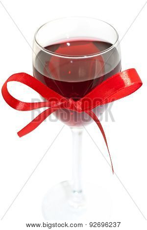 wineglass with wine and ribbon