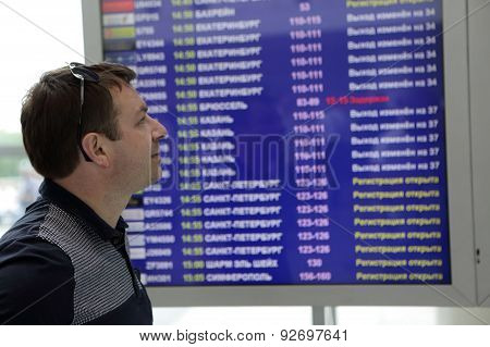 Man Looking At Arrival Board