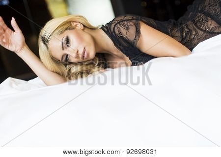 Young Woman On The Bed