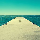 picture of bollard  - picture of a concrete dock with some mooring bollards in the Mediterranean sea - JPG
