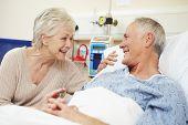 pic of visitation  - Senior Female Visiting Husband In Hospital Bed - JPG