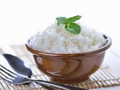 stock photo of ceramic bowl  - Cooked white rice garnished with mint in a ceramic bowl - JPG