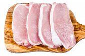 stock photo of shoulder-blade  - Boneless Pork Loin Steaks on cutting board - JPG