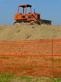 pic of grub  - old orange bulldozer stops waiting for work - JPG