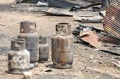 picture of petroleum  - Burnt liquid petroleum gas cylinder in fire situation - JPG